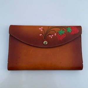 Vintage leather strawberry wallet.